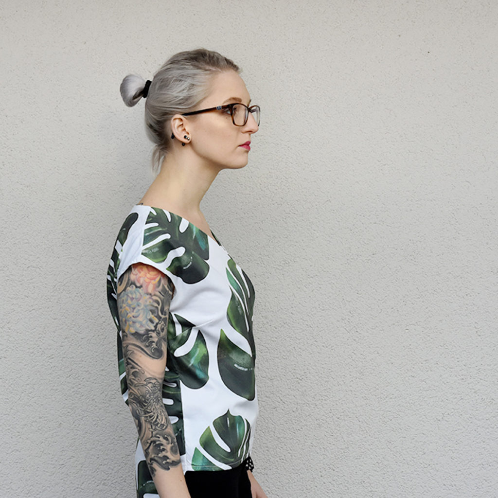 woman wearing monstera pattern shirt